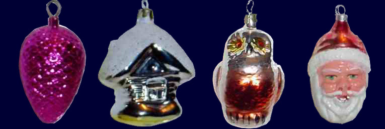 Woolworth Glass Christmas Decorations from the late nineteenth century. Each was blown by a German craftsman.  Left to right: acorn, cootage, owl and Santa (Saint Nick).