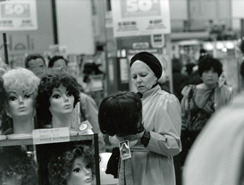 Women buying wigs in the closing down sale at Woolworths in San Francisco