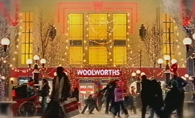 An idyllic scene outisde a British Woolworths store in the early 2000s, as conveyed in the Company's Christmas advertising